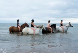 Guests riding bareback about to enjoy a swim in the sea at Brunerican beach.